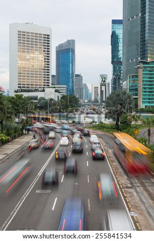 Cars captured with blurred motion drive around the Plaza Indonesia roundabout in Jakarta, Indonesia capital city - stock photo