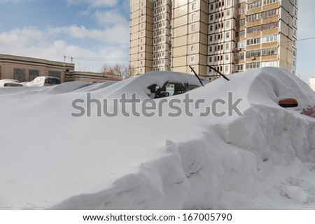 Cars covered in snow after a blizzard - stock photo