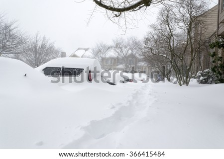 Cars covered in snow during snow Blizzard in Washington DC area. Virginia. Bull's eye of storm. January 23 2016 - stock photo