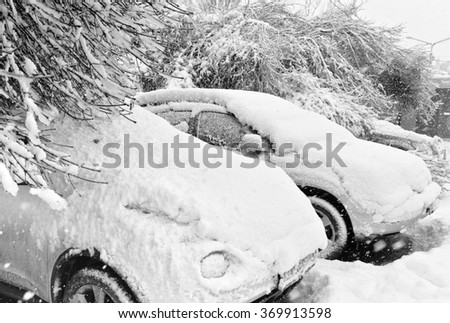 Cars covered with fresh white snow - stock photo