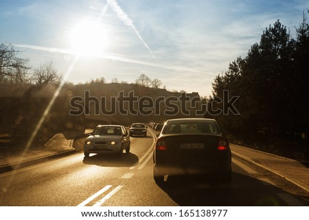 Cars driving fast on country road