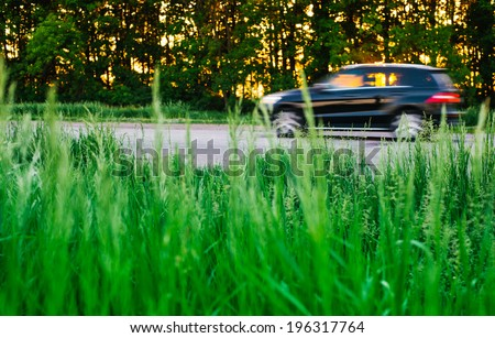 cars driving on a road - stock photo