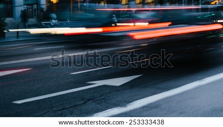 Cars in a Blurred City Scene - stock photo