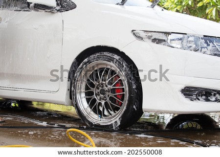 cars in a carwash. - stock photo
