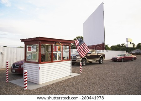 Cars in line buying tickets to Star Drive In Movie Theater, Montrose, Colorado, USA, 07.06.2014 - stock photo