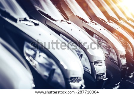 Cars in Stock Closeup. Row of Brand New Cars For Sale. New Cars Industry. - stock photo