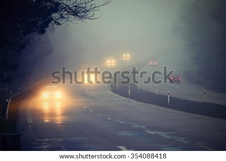 Cars in the fog - stock photo