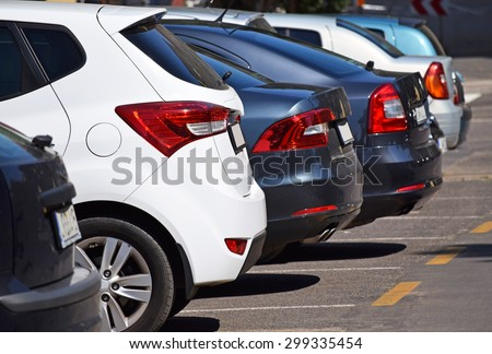 Cars in the parking lot - stock photo