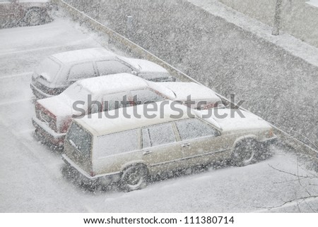 Cars in the snowstorm - stock photo