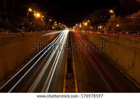 cars light trails at a tunnel entrance during night long exposure