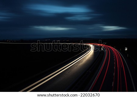 Cars moving fast on a highway. - stock photo