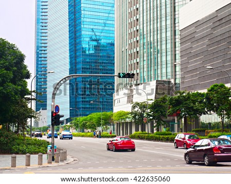 Cars on a road in Singapore Downtown Core. - stock photo