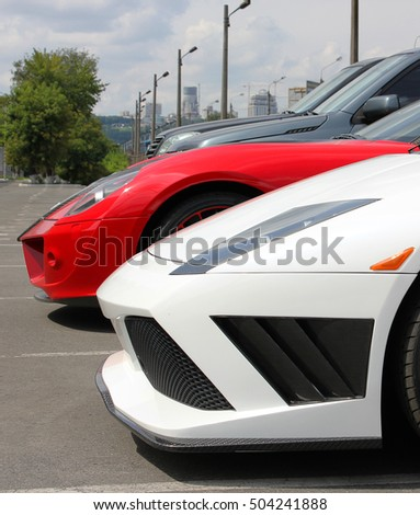 Cars on city background. Two supercar. luxury cars