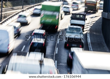 cars on highway in curve - stock photo
