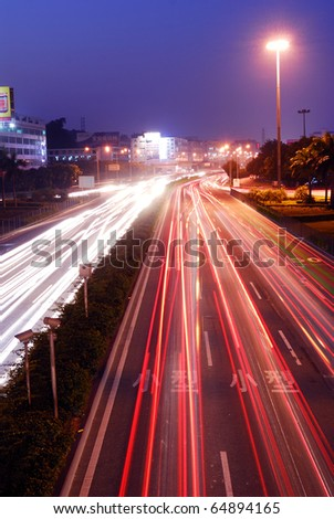 Cars on the road, a busy urban traffic - stock photo