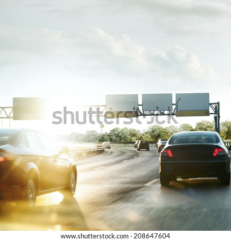Cars on the road Driving fast - stock photo