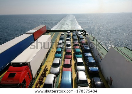 Cars parked on a ferry. - stock photo