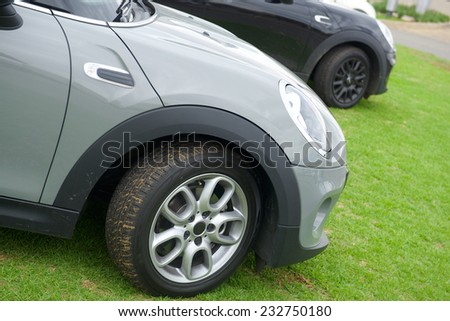 Cars parked on grass