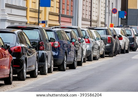 cars parked on the roadside - stock photo