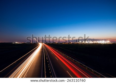 Cars speeding on a highway near city Szeged, Hungary - stock photo