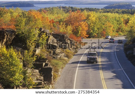 Cars traveling through Acadia National Park, Maine - stock photo