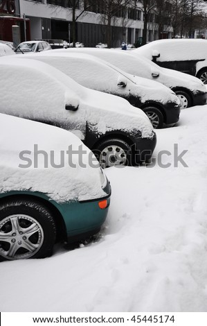Cars under snow. Parked cars under snow. - stock photo
