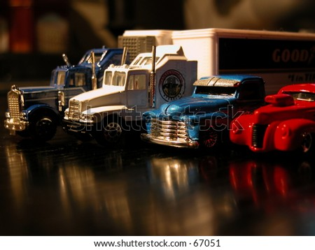 Cars: various lined up truck models - stock photo