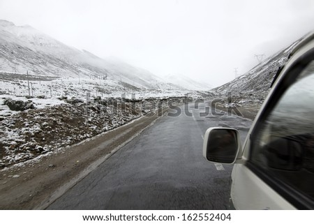 Cars with mountains in the snow