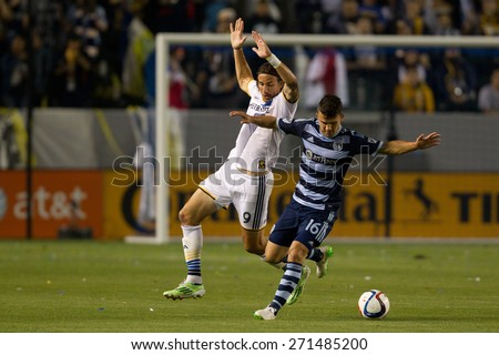 CARSON, CA. - APR 18: Servando Carrasco & Alan Gordon (L) in action during the L.A. Galaxy game against Sporting Kansas City on April 18, 2015 at the StubHub Center in Carson, California. - stock photo