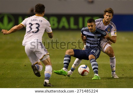 CARSON, CA. - APR 18: Tommy Meyer & Dominic Dwyer (mid) in action during the L.A. Galaxy game against Sporting Kansas City on April 18, 2015 at the StubHub Center in Carson, California. - stock photo