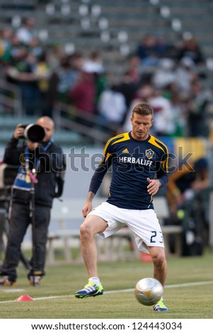 CARSON, CA - APRIL 14: David Beckham warms up before the MLS game between the Los Angeles Galaxy and the Portland Timbers on April 14th 2012 at the Home Depot Center in Carson, Ca. - stock photo