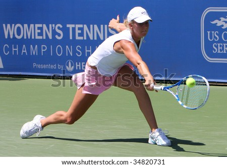 CARSON, CA - AUG. 4: WTA player, Julie Coim from France, competing at the L.A. Women's Tennis Championships August 4, 2009 in Carson, California