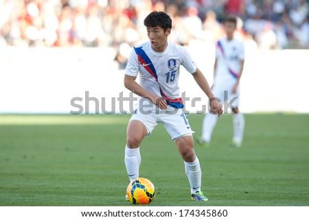 CARSON, CA. - FEB 01: Korea M Min-Woo Kim #15 in action during the U.S. mens national team soccer friendly against Korea Republic on Feb 1st 2014 at the StubHub Center in Carson, Ca. - stock photo