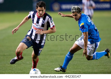 CARSON, CA. - JANUARY 10: Dario Carreno (L) and Manuel Lopez (R) in action during InterLiga 2010 match of Puebla vs. Monterrey at the Home Depot Center on January 10, 2010 in Carson. - stock photo