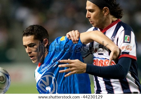 CARSON, CA. - JANUARY 10: Hercules Gomez (L) and Duillo Davino (R) in action during InterLiga 2010 match of Puebla vs. Monterrey at the Home Depot Center on January 10, 2010 in Carson. - stock photo