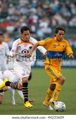 CARSON, CA. - JANUARY 10: Oscar Razo (L) and Lucas Lobos (R) in action during the InterLiga 2010 match of Tigres vs. Jaguares at the Home Depot Center on January 10, 2010 in Carson.