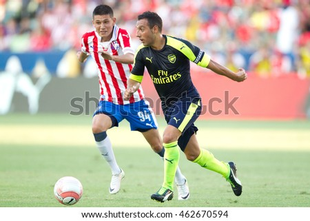 CARSON, CA - JULY 31: Santi Cazorla in action during the friendly soccer game between Chivas Guadalajara and Arsenal on July 31st 2016 at the StubHub Center.