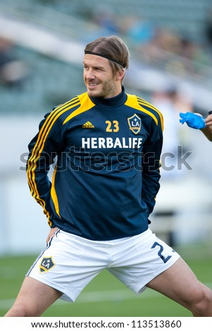 CARSON, CA - MARCH 18: David Beckham warms up before the MLS match between the LA Galaxy and DC United on March 18, 2012 at the Home Depot Center in Carson, Ca. - stock photo