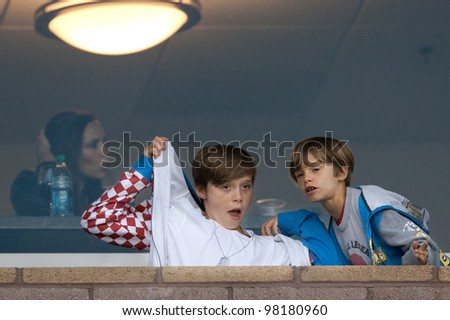 CARSON, CA. - MAY 14: Victoria Beckham, Brooklyn Beckham, and Romeo Beckham (L-R) during a Los Angeles Galaxy MLS game on May 14 2011 at the Home Depot Center in Carson, CA. - stock photo