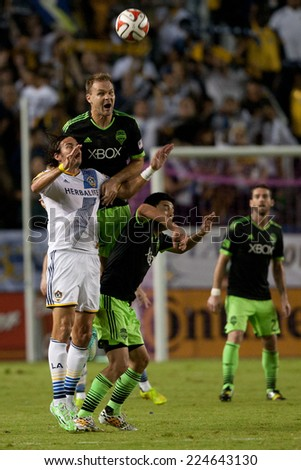 CARSON, CA - OCT 19: Chad Marshall, Gonzalo Pineda, & Alan Gordon fight for the ball during the Los Angeles Galaxy MLS game against the Seattle Sounders on October 19th 2014 at the StubHub Center. - stock photo