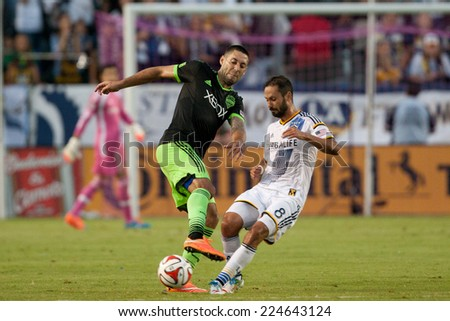 CARSON, CA - OCT 19: Clint Dempsey & Marcelo Sarvas (R) in action during the Los Angeles Galaxy MLS game against the Seattle Sounders on October 19th 2014 at the StubHub Center. - stock photo