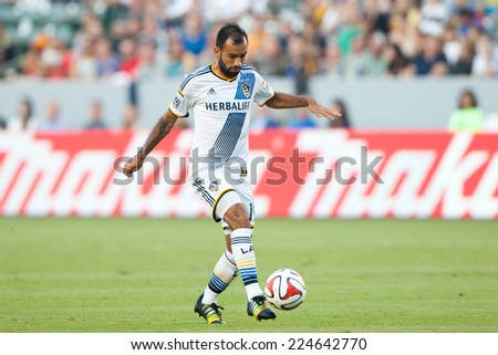 CARSON, CA - OCT 19: Juninho in action during the Los Angeles Galaxy MLS game against the Seattle Sounders on October 19th 2014 at the StubHub Center. - stock photo