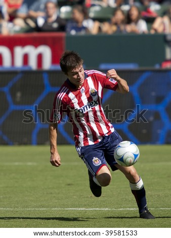 CARSON, CA. - OCTOBER 25: Jorge Flores dribbles the ball during the Chivas USA vs. Houston Dynamo match on October 25th, 2009 at the Home Depot Center in Carson.