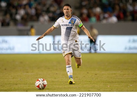 CARSON, CA - SEPT 28:  Robbie Keane during the Los Angeles Galaxy MLS game against the New York Red Bulls on Sept 28th 2014 at the StubHub Center. - stock photo