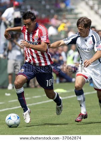 CARSON, CA. - SEPTEMBER 13: Jesus Padilla (L) and Wells Thompson (R) during the Chivas USA vs. New England Revolution match on September 13, 2009 at the Home Depot Center in Carson.