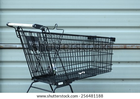 Cart and trash - stock photo