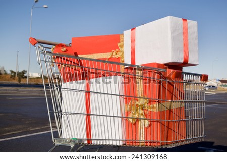 Cart store with shopping in a parking lot - stock photo