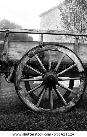 Cart Wheel standing near the house close-up.