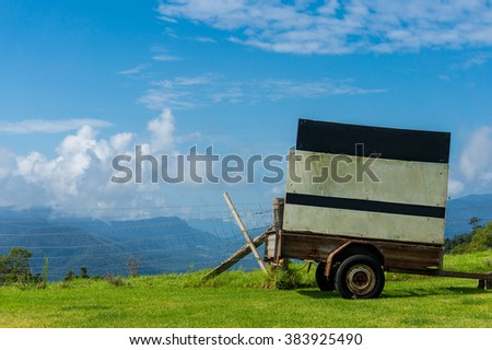Cart with clear billboard against rural background. Rural scene with copy space. Creative rural, agriculture advertising in Australian outback