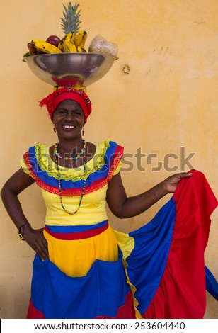 Cartagena, Colombia - February 22, 2014 - A woman in the iconic fruit selling costume of the Palenqueras, Cartagena Colombia.
